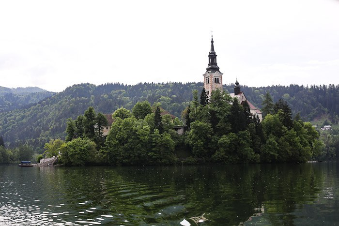 Eastern Europe Slovenia Travel Tourist Lake Bled Pletna Boat Church Mary Row Oars Mountains Steps Monk Stairs Legend Tradition Water Serene Green Scenic