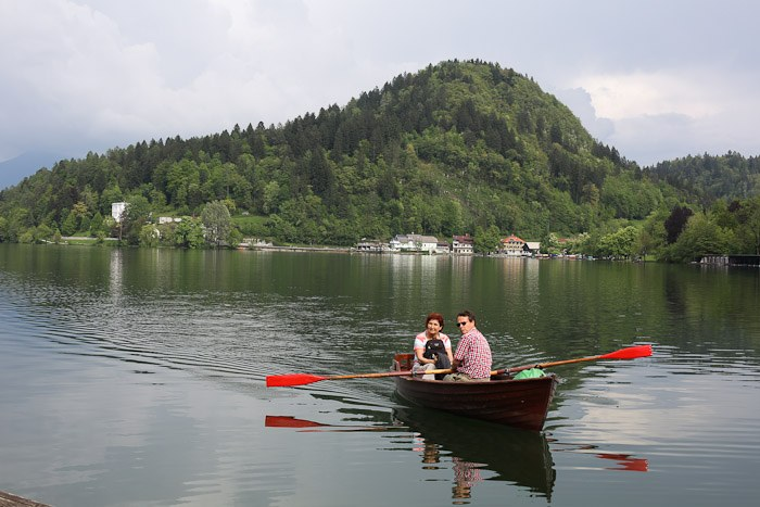Eastern Europe Slovenia Travel Tourist Lake Bled Pletna Boat Church Mary Row Oars Mountains Steps Monk Stairs Legend Tradition Water Serene Green Scenic chandelier Ring Bell wish couple romantic