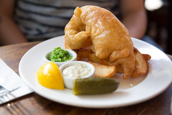 fish and chips lunch uk england food fried cod mashed peas