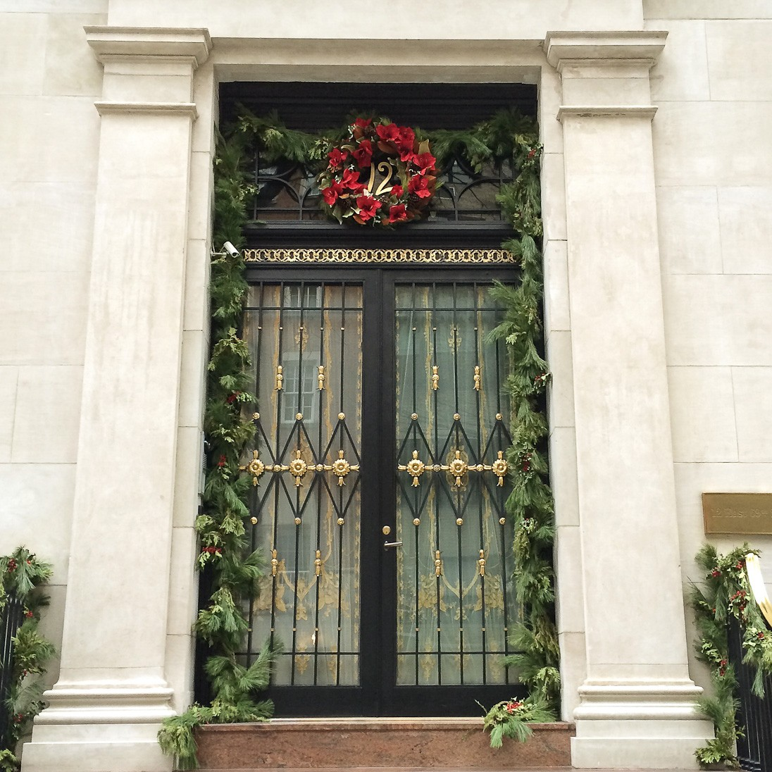 christmas scenes inspiration doors wreaths garland december winter new york city nyc sher she goes shershegoes.com