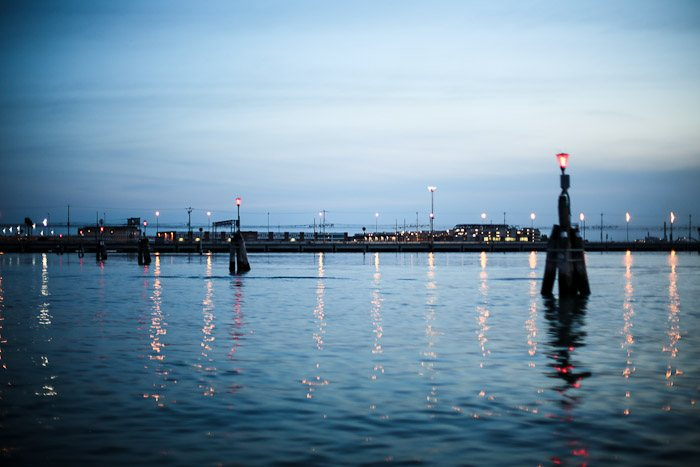 europe italy travel lagoon sea ocean water lights glimmer pier reflection sunset color